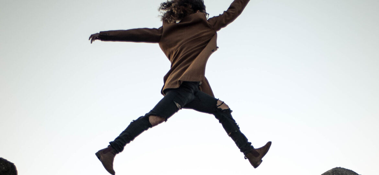 woman jumping rockfall